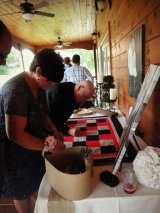 Molly (Casey's mom) signing the quilt!