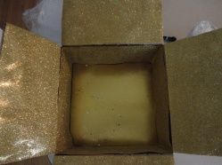 I started with a box and lined it with gold and glitter gold paper.