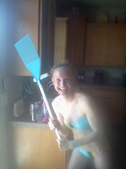 Tanning in the backyard at CCs. We needed a bug swatter. This is what my cousin Brittnie came out with.