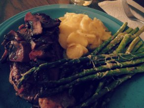 Mardi Gras menu: New York steak with red wine and portobello mushroom sauce, scalloped potatoes and baked asparagus with parmesan.