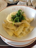 """Raviolis with truffles and cream sauce. """"Rocket Salad"""" to top it off."""