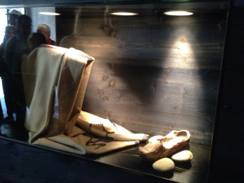 St Bernadette's family became very poor in her adolescence. Their home was incredibly poor - unfit to even be a prison. These are the only belongings that she had I believe. a cloak, some clogs and her rosary.