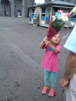 Sweet Mary Rose carrying flowers through the candlelight procession.