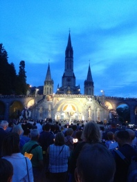 Pilgrims light candles and process up to the Basilica, praying the Rosary and singing songs of praise.