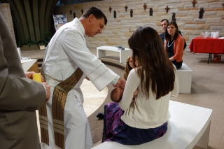 Anointing John-Paul before his Baptism.
