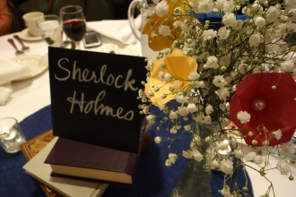Adorable paper flowers and literature themed centerpieces.