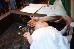 Abby is made new in Christ through the waters of Baptism. In this moment she is washed of all Original Sin!