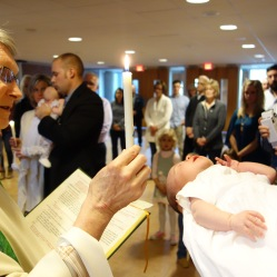 The Light of Christ that dwells in Abby is symbolized through her Baptismal candle.
