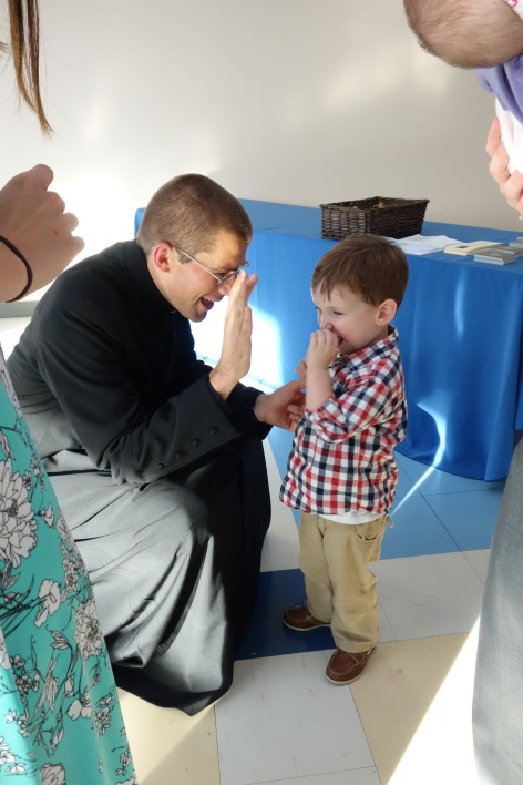 High fives for the brand new priest, Father Michael!