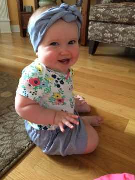 Abby in her mommy and me skirt and headband made by Bea!