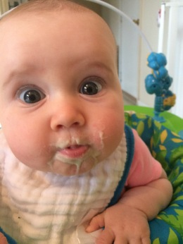 Our silly girl eating some of her first solid foods
